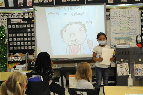 Student presenting MLK drawing
